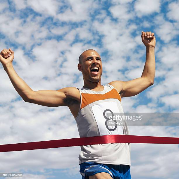 low angle view of man running, reaching finish line
