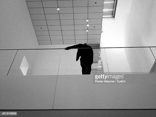 Low angle view of man standing on balcony