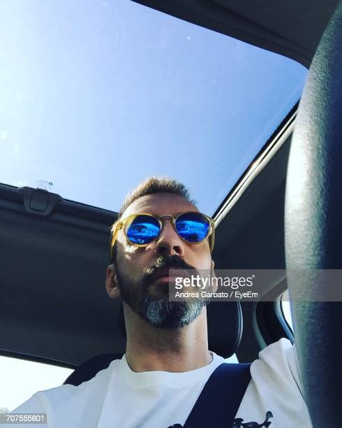 Low Angle View Of Man Traveling In Car