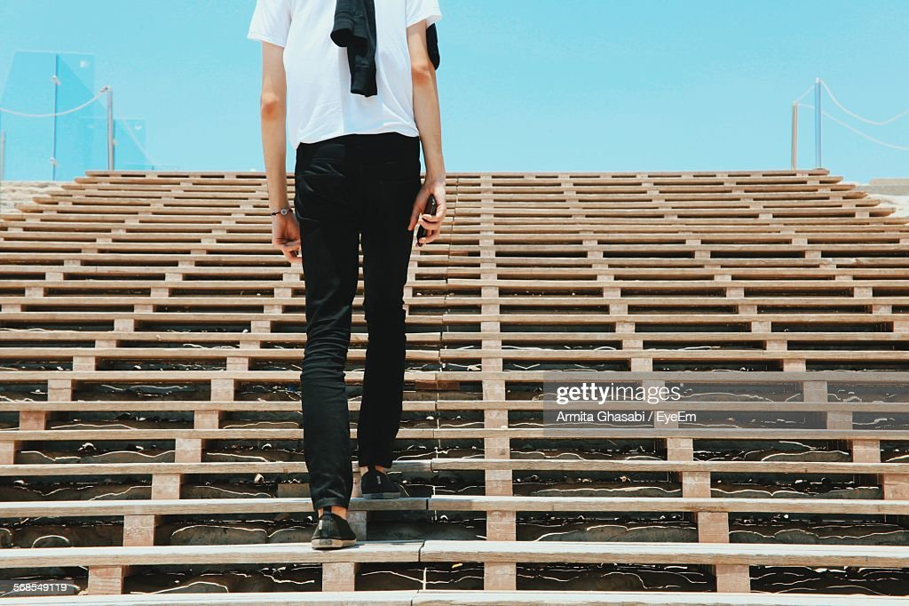 Low Angle View Of Man Walking On Steps : Stock Photo