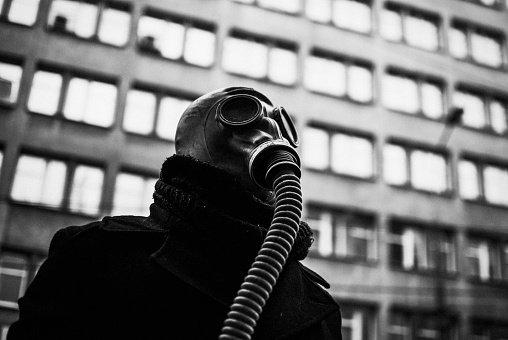 Low Angle View Of Man Wearing Gas Mask - gettyimageskorea