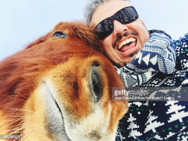 Low Angle View Of Man With Horse