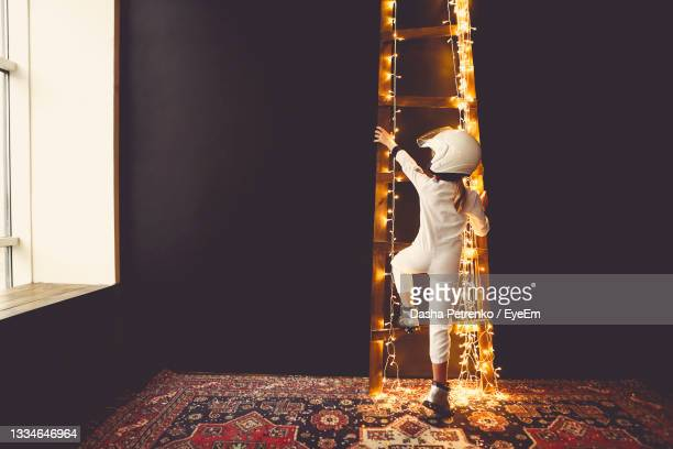 low angle view of man working at night - silver boot stock pictures, royalty-free photos & images