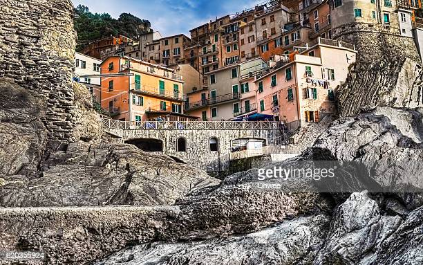 Low Angle View Of Manarola Village, Framed By The Rock, Italy.