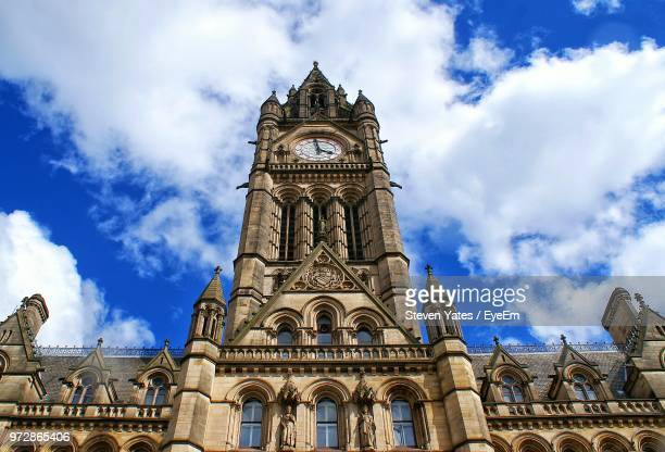 low angle view of manchester town hall against sky - town hall stock photos and pictures
