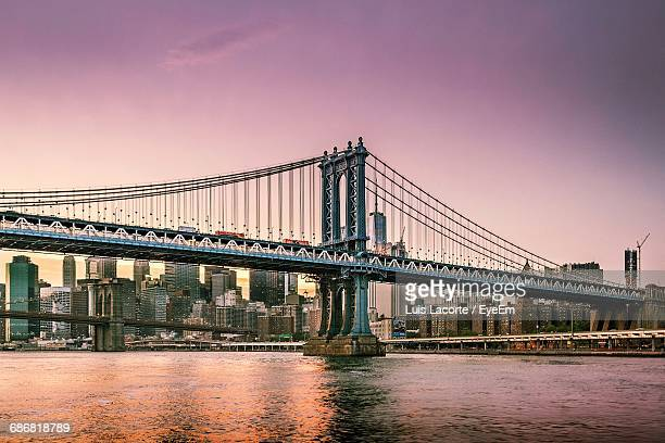 Low Angle View Of Manhattan Bridge Against Skyline At Dusk