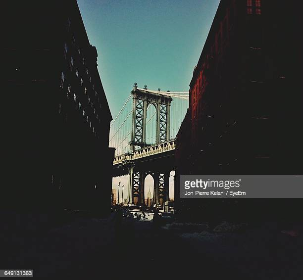 Low Angle View Of Manhattan Bridge And Buildings In City