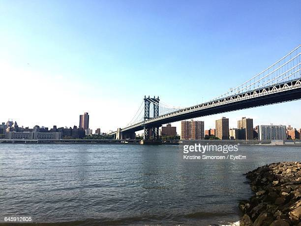 Low Angle View Of Manhattan Bridge Over East River In City Against Clear Sky
