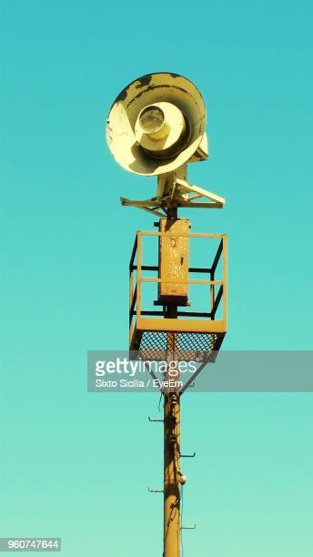 Low Angle View Of Megaphone On Pole Against Clear Sky