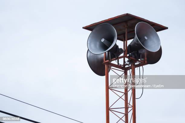 low angle view of megaphones on metallic tower against sky - megaphone stock pictures, royalty-free photos & images