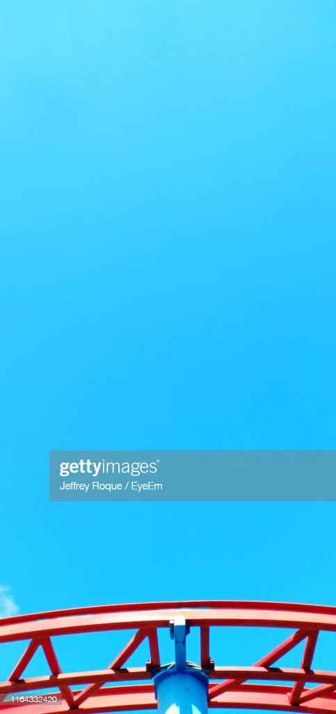 Low Angle View Of Metal Against Clear Blue Sky : Stock Photo