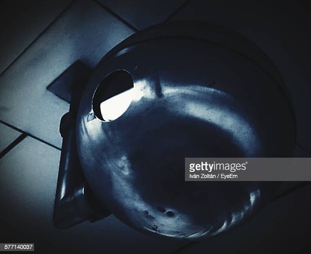 low angle view of metal ball hanging from ceiling - iván zoltán stock pictures, royalty-free photos & images