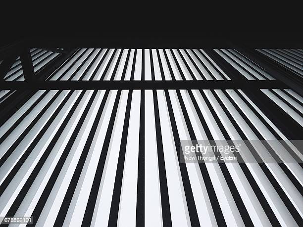 Low Angle View Of Metal Bars Of Fence