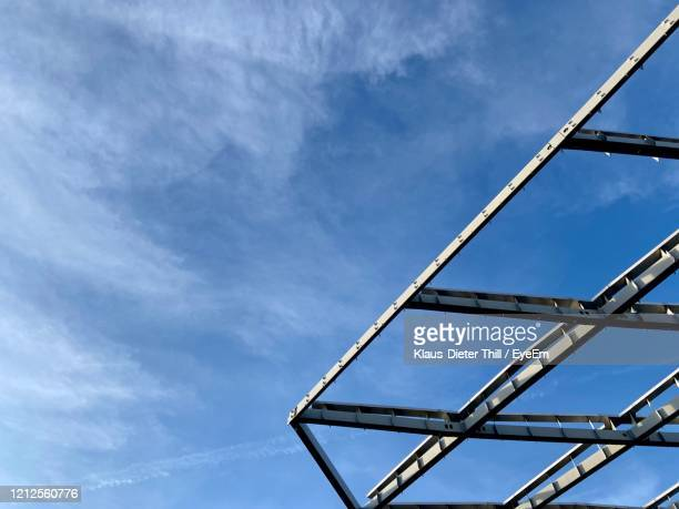 low angle view of metal construction  against blue sky - klaus-dieter thill stock-fotos und bilder
