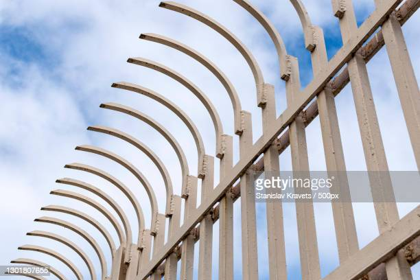 low angle view of metal fence against sky,brooklyn,new york,united states,usa - brooklyn new york stock pictures, royalty-free photos & images