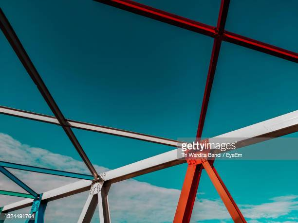 low angle view of metallic structure against blue sky - south east asia stock pictures, royalty-free photos & images