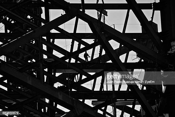 low angle view of metallic structure at construction site - mexico black and white stock pictures, royalty-free photos & images