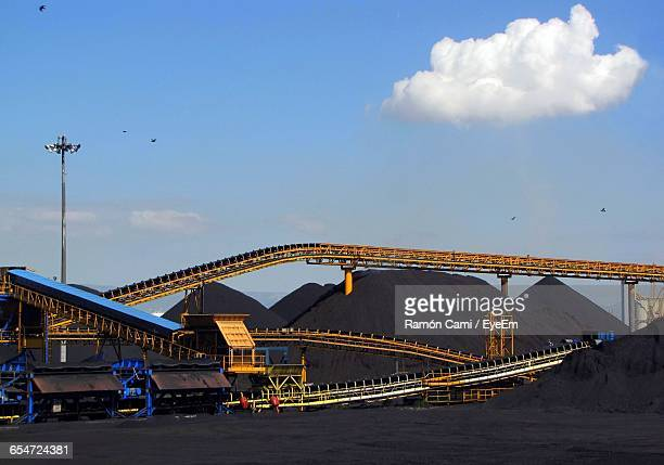 Low Angle View Of Metallic Structures At Coal Industry Against Sky