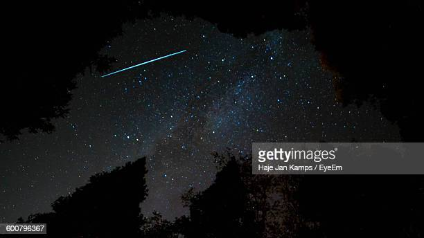 Low Angle View Of Meteor With Stars In Sky At Night