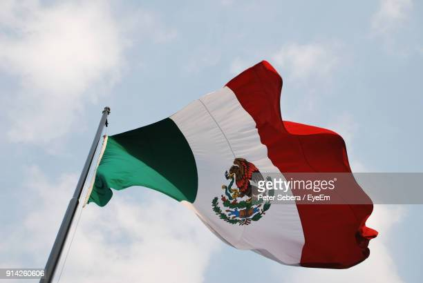 low angle view of mexican flag against clear blue sky - bandera mexicana fotografías e imágenes de stock