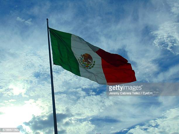 low angle view of mexican flag against sky - mexican flag stock pictures, royalty-free photos & images