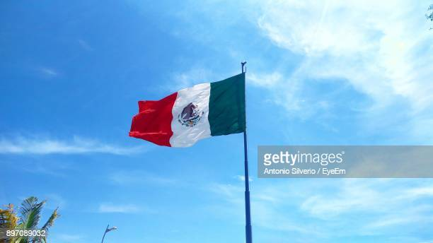 Low Angle View Of Mexican Flag Against Sky
