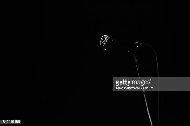 Low Angle View Of Microphone Against Black Background