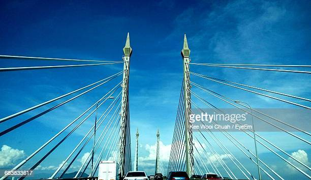 Low Angle View Of Modern Bridge Against Blue Sky