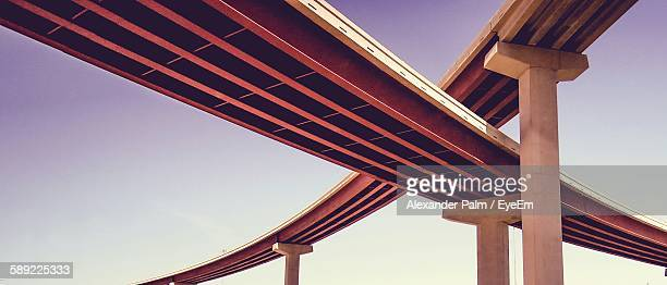 low angle view of modern bridges against clear sky - puente fotografías e imágenes de stock