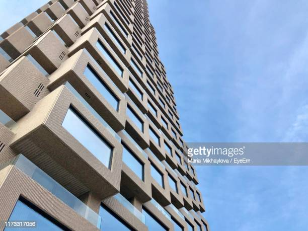 low angle view of modern building against blue sky - stockholm stock pictures, royalty-free photos & images