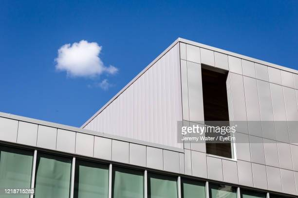 low angle view of modern building against blue sky - eyeem jeremy walter stock pictures, royalty-free photos & images