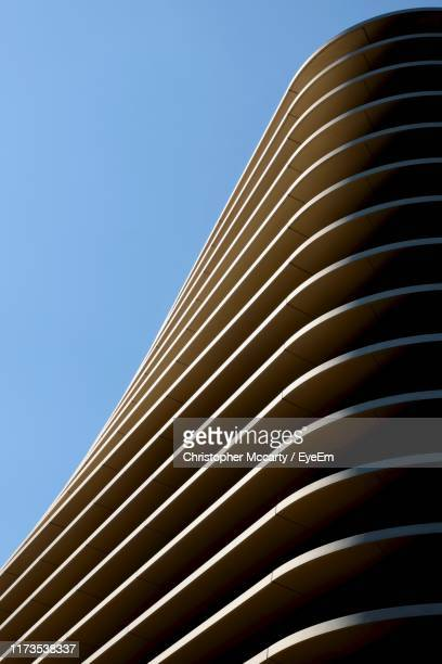 low angle view of modern building against clear blue sky - poland stock pictures, royalty-free photos & images
