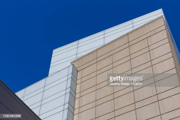 low angle view of modern building against clear blue sky - eyeem jeremy walter stock pictures, royalty-free photos & images