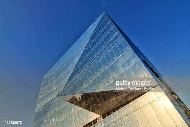 low angle view of modern building against clear blue sky - headquarters stock pictures, royalty-free photos & images