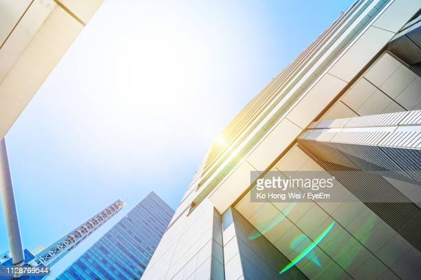 low angle view of modern building against clear sky - saitama prefecture stock pictures, royalty-free photos & images