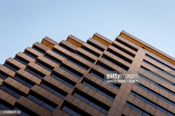 low angle view of modern building against clear sky - eyeem jeremy walter stock pictures, royalty-free photos & images