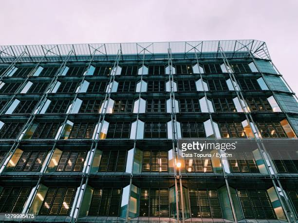 low angle view of modern building against clear sky - data topuria stock pictures, royalty-free photos & images