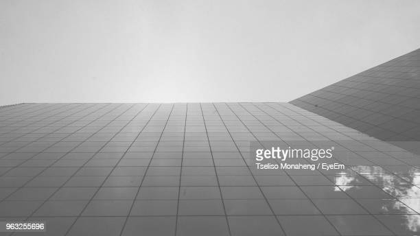 low angle view of modern building against clear sky - sandton stock pictures, royalty-free photos & images