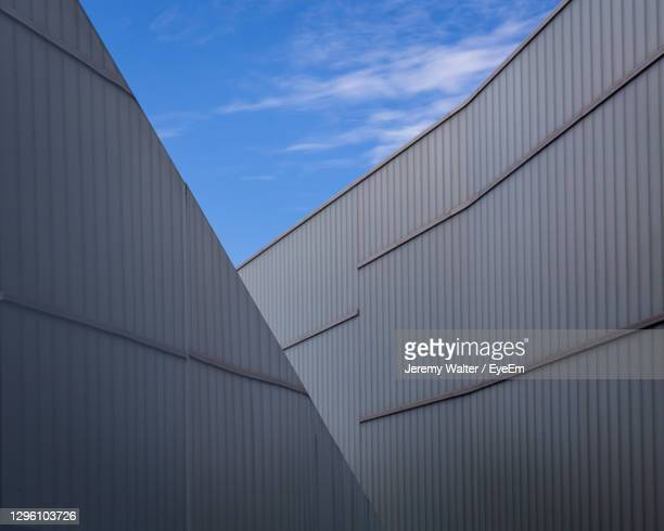 low angle view of modern building against sky. abstract architecture background. - eyeem jeremy walter stock pictures, royalty-free photos & images