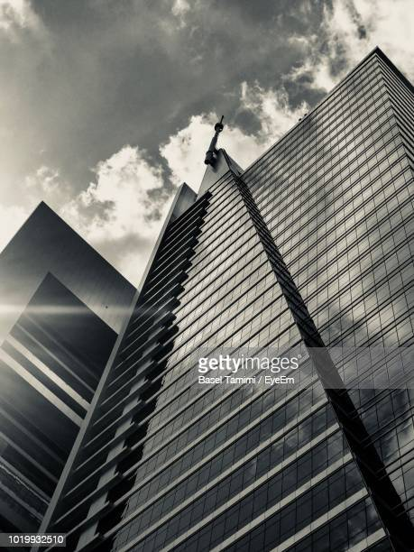 low angle view of modern building against sky - riyadh stock pictures, royalty-free photos & images