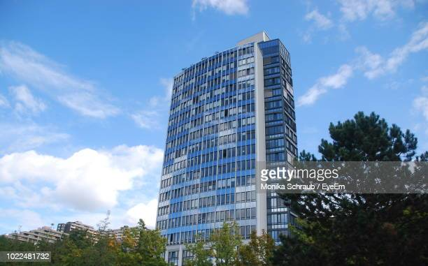 low angle view of modern building against sky - heidelberg stock photos and pictures
