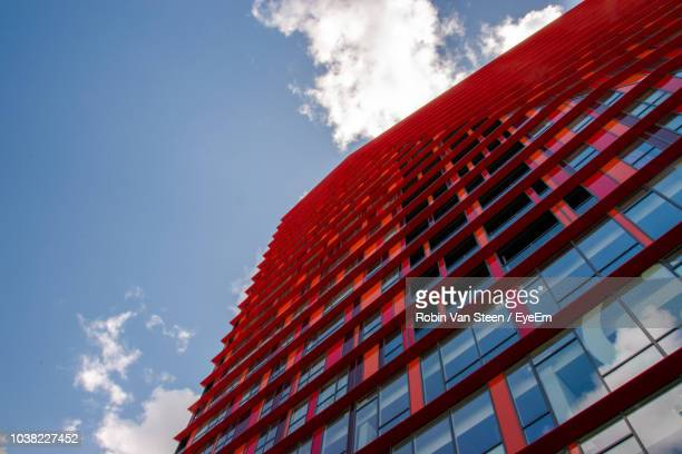low angle view of modern building against sky - rotterdam photos et images de collection