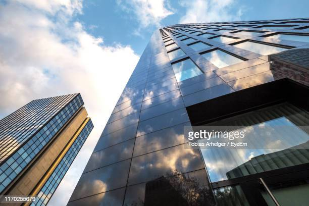 low angle view of modern building against sky - dortmund city stock pictures, royalty-free photos & images