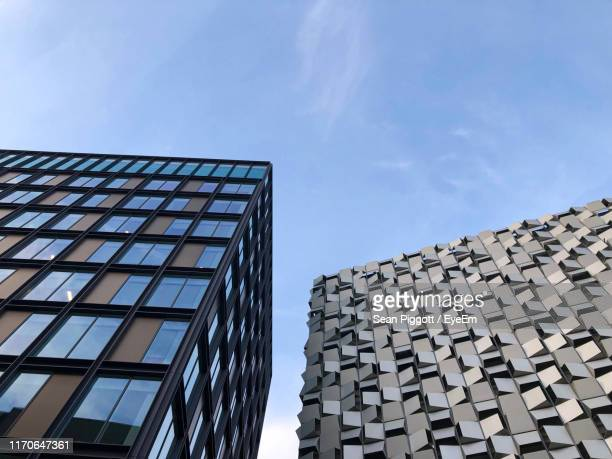 low angle view of modern building against sky - sheffield stock pictures, royalty-free photos & images