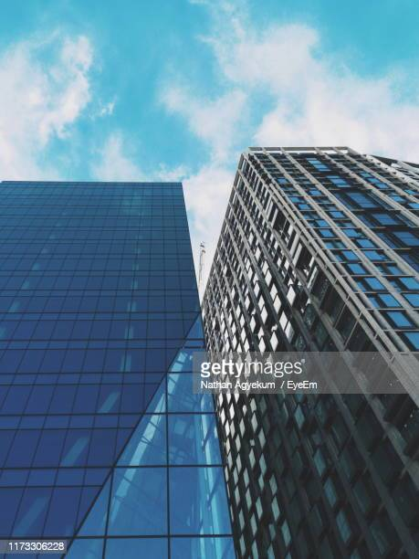 low angle view of modern building against sky - waterloo railway station london stock pictures, royalty-free photos & images
