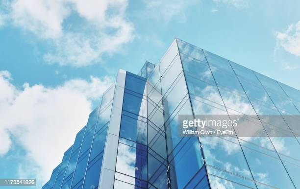 low angle view of modern building against sky - building exterior stock pictures, royalty-free photos & images