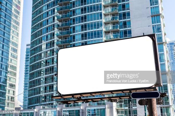low angle view of modern building against sky - toronto stock pictures, royalty-free photos & images