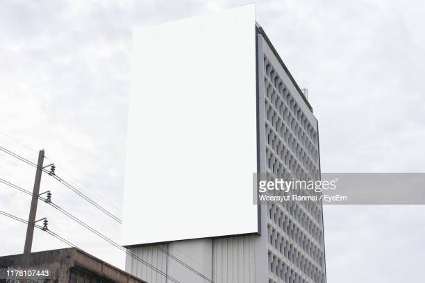 low angle view of modern building against sky - template stock pictures, royalty-free photos & images