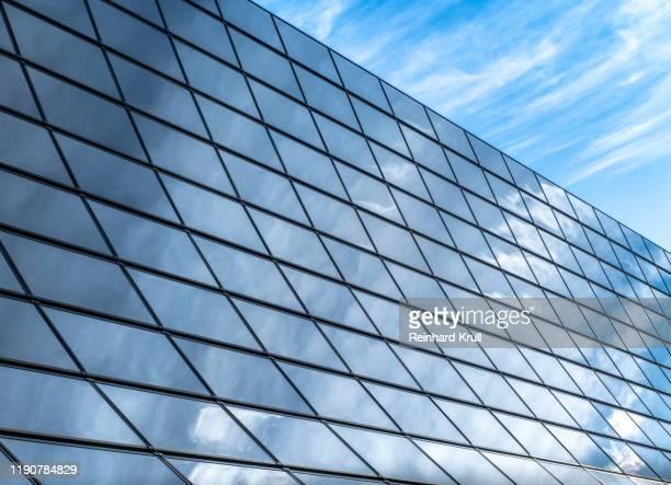 low angle view of modern building against sky - steuerpult stock-fotos und bilder
