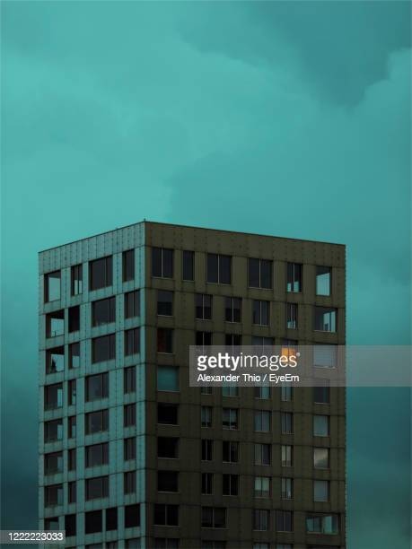 low angle view of modern building against sky - antwerpen stad stockfoto's en -beelden
